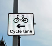 Cycle lane sign. On post set against a blue sky in the United Kingdom Stock Images