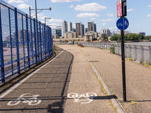 Cycle lane with white bycicle sign on tarmac Royalty Free Stock Images