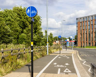 Cycle path. City cycle path besides a road and a pedestrian footpath Stock Images
