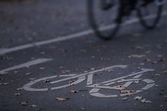 cycle path in early morning light with bicycle - urban commuting stock photos