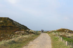 Cycle path on the island of Sylt. The bike path in south of the North Sea island of Sylt follows in parts of the route of the former Island Railway. The picture royalty free stock image