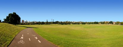 Cycle Path Panorama. Shared Pedestrian bicycle path through park Stock Images