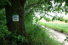 Cycle path sign in the countryside landscape stock photos