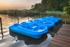 Cycle Pedal Boat. Row of Blue Pedal Rental Boats on a Foggy Morning at Zuidlaardermeer, Netherlands Royalty Free Stock Images