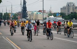 Cycle race in Moscow. Many people ride bikes. They participate in a cycle race in Moscow city center on June 16, 2013 in Moscow. The Moscow river embankment Royalty Free Stock Photos