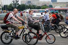 Cycle race in Moscow. Men on bikes. Royalty Free Stock Photo
