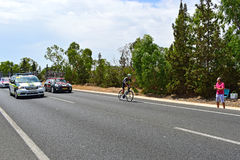 Cycle Racing A Rider Ahead Of The Team Cars. The rider at the back of the peleton during stage 9 of La Vuelta Espana 2017 Stock Photos