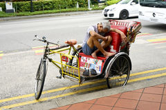 Cycle Rickshaw driver having a rest Royalty Free Stock Photos