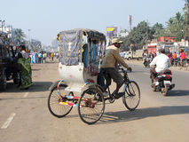 Cycle rickshaw in the main street of Puri Stock Photography