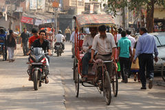 Cycle rickshaw and passenger. Old Delhi, India. Royalty Free Stock Photo