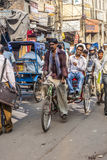 Cycle rickshaw with passengers in the streets of Delhi Stock Photos