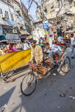 Cycle rickshaw with passengers in the streets of Delhi Royalty Free Stock Photos
