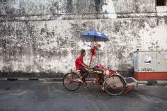 Cycle rickshaw is riding down the street, Penang, Malaysia Stock Photos