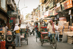 Cycle rickshaw riding the vehicle on the street of Old Delhi, India Stock Photography