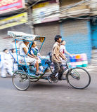 Cycle rickshaw transports passenger in Delhi, India. DELHI, INDIA - OCT 16: cycle rickshaw transports passenger early morning on October 16,2012 in Delhi, India royalty free stock photo