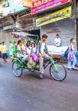 Cycle rickshaw transports passenger in Delhi, India Stock Image