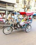 Cycle rickshaw transports passenger in Delhi, India Royalty Free Stock Image