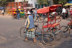 Cycle rickshaw walking in the street of Delhi, India Stock Photos