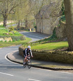 Cycle road racer on a country road at Odell Bedfordshire. Odell, Bedfordshire, England - April 03, 2016: Cycle road racer on a country road at Odell Bedfordshire stock images