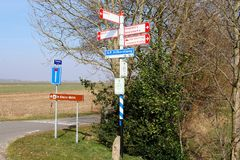 Cycle route signs rural landscape, Netherlands. Cycle road sign boards to Amersfoort, Soest, Baarn and the bike boat Eemlijn in countryside, Netherlands Stock Image