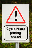 Cycle route sign and signpost. At side of road Stock Images