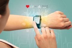 Cycle and smartwatch concept. Hand with smartwatch and cycling concept nearby Royalty Free Stock Images