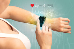 Cycle and smartwatch concept. Stock Photo