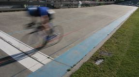 Cycle sprint winner. A lone cyclist crosses the finish line, his competitor having suffered mechanical faliure of some kind on the track Royalty Free Stock Photo