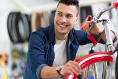 Cycle technician in workshop Stock Photos