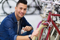 Cycle technician in workshop Royalty Free Stock Image
