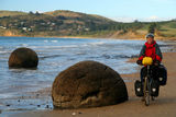 Cycle tourer on the New Zealand beach Stock Photo