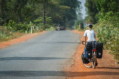 Cycle touring in Cambodia royalty free stock image