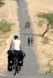 Cycle touring in India. Woman on a cycle touring trip in rural part of India Royalty Free Stock Photo