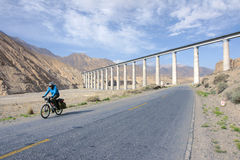 Cycle touring. In Kunlun Mountain in Qinghai, China Royalty Free Stock Images