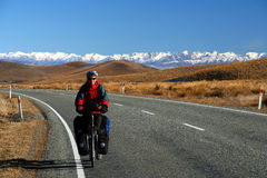 Cycle touring in New Zealand. Woman on a cycle touring trip in New Zealand Royalty Free Stock Images