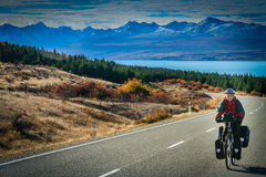 Cycle touring in New Zealand. Woman on a cycle touring trip in New Zealand stock photo