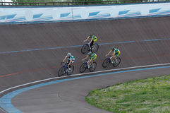 Cycle track. Racing on the cycle track. Girls-cyclist on the cyc. Cycle track. Racing on the cycle track. Girls-on cycle track.Chempionat cyclist. Cycling Team Stock Photos