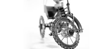 Cycle on a white background. On a white background, close of shot of toy tricycle Stock Photo
