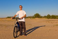 Cycler in a desert Royalty Free Stock Images