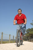 Cycler on the seaside walking with bike Royalty Free Stock Image