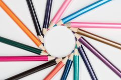 Cyclic circle of pencils. Frame of pencils laid out in a circle in a cyclic order, on a white background Stock Photography