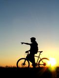 Cycling. Mountain biker girl silhouette in sunrise stock images
