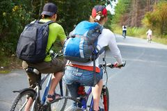 Cycling. Couple cycling on road in park Royalty Free Stock Photo