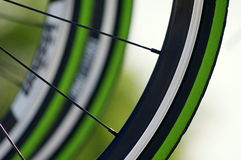 Cycling. Macro shot of professional cycling bike wheels Royalty Free Stock Photo