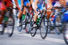 Cycling. Zoom effect of people cycling stock images