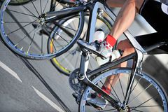 Cycling. A leg of a caucasian cyclist riding his bike in a road race Royalty Free Stock Photos