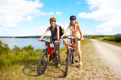 Cycling. Mother and a daughter cycling near the lake Royalty Free Stock Image