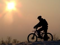Cycling. Mountain biker - snowrider Royalty Free Stock Images