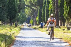 Cycling along Appia Antica royalty free stock photo