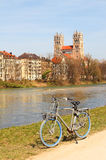 Cycling along the riverside of isar river, munich Stock Image